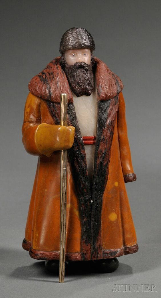Russian Hardstone Figure of a Mujik, 19th/20th century, style of Peter Carl Faberge, the peasant composed of various Russian stones and holding a gilt metal staff.