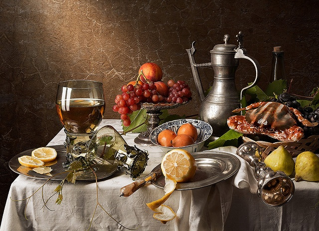 Still life with crab, grapes, peaches and figs