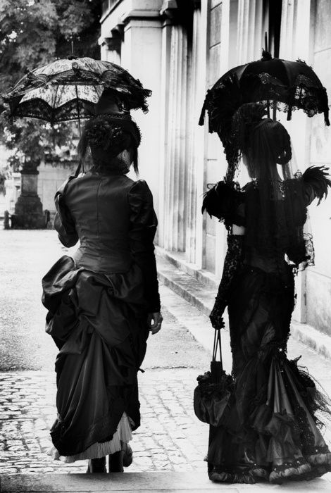 Shadowy ladies having a pleasant enough stroll as they swap Secrets and Whispers.
