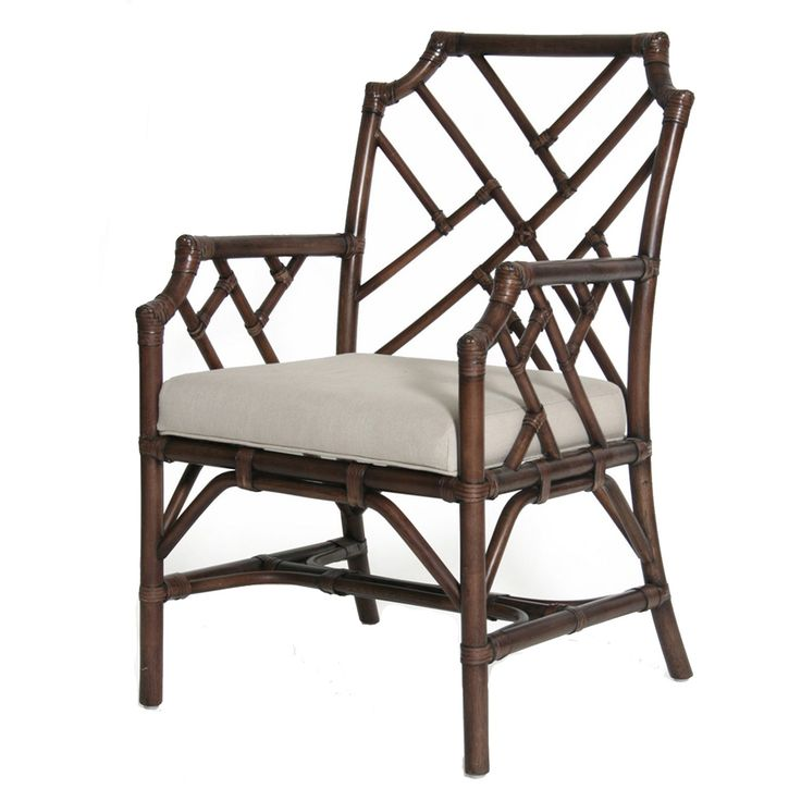 "The Palm Beach Chippendale Arm Chair is part of the a uniquely styled, trend forward collection of quality furniture great for any coastal home, beach cottage, lake house, office, contemporary or traditional residence. Rattan Frame with Leather Binding. 3"" thick cushion Cushion Fabric - Polyester 45%, Linen 55%. Color: Mahogany"