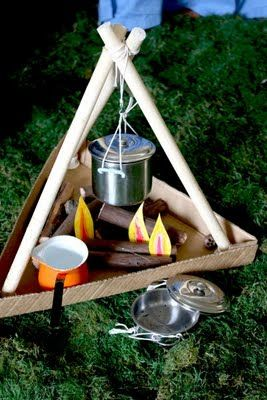 Kids pretend camp fire.  How cozy would this be in the classroom in a reading corner!