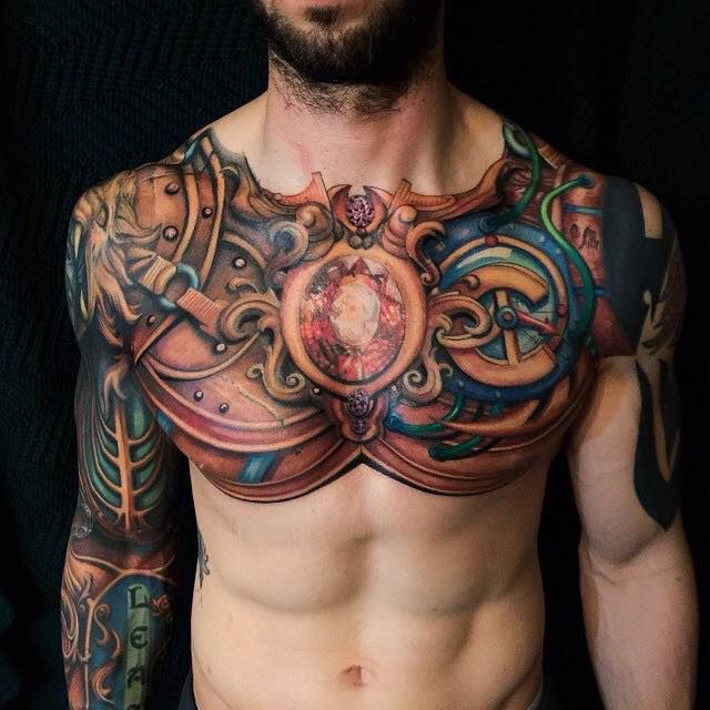 Full Sleeve Armor And Chest Tattoo By Steven Mckenzie