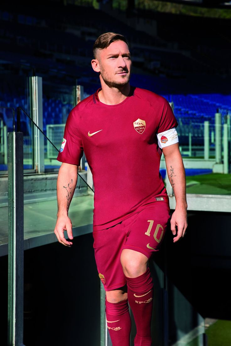 Captain Francesco Totti unveils the special AS Roma commemorative kit for the 'Derby della Capitale
