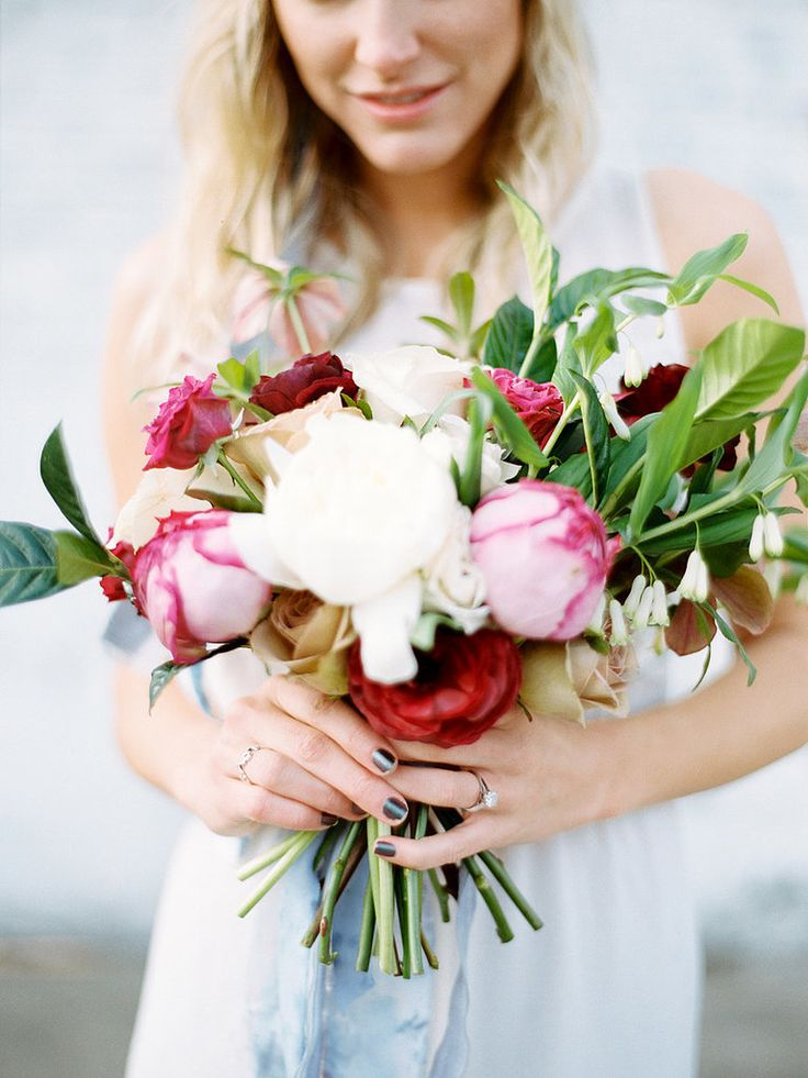 The photo op: You've got to hold your bouquet, right? So why not use it as an opportunity to get a shot of the beautiful floral arrangement and your ring? Juxtaposing natural elements with stonework adds interest, too. Photo by Brumley & Wells via Style Me Pretty