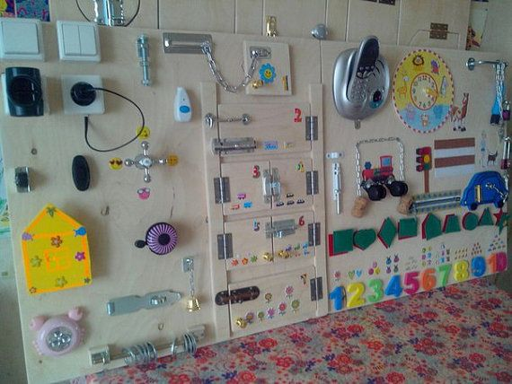 Busy Board: 35 different elements. Size: 120x60 centimeter  Toy for children from 6months and up to 5-7 years. Busy Bord develop * coordination * imagination * perseverance * skills of using simple locks * fine motor skills =============================== Attention!!!!!!!! All products in the store are made on the order of 5 to 19 days. The color, size, shape, objects may be different from the photo. Exact repetition is not possible. ============================== Thanks)