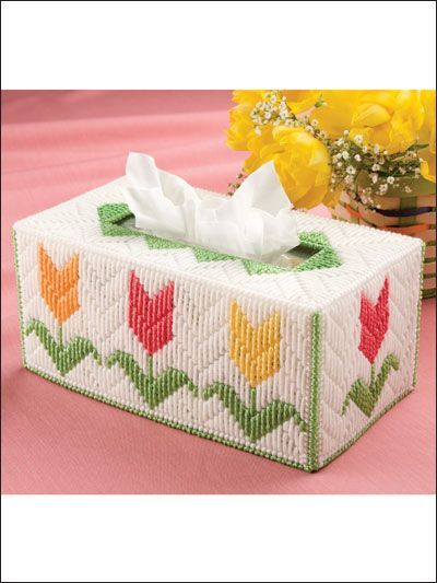 """The tulips on this tissue cover """"come alive"""" when using the long stitch.Size: Fits medium-count tissue box. Made with medium (worsted) weight yarn and 7-count plastic canvas.Skill Level: Beginner"""