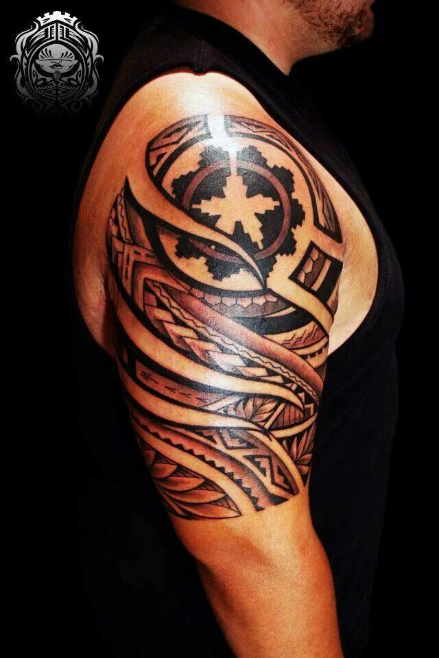 Fred Frost Tattoo: My Husbands Arm. Navajo Design with Samoan & Tongan.