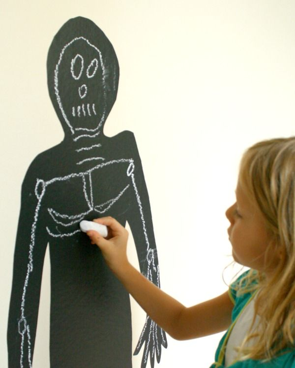 Learn about bones and the human skeleton with this chalk skeleton craft. It's great for Halloween and science. We use ours as a Halloween decoration, too!