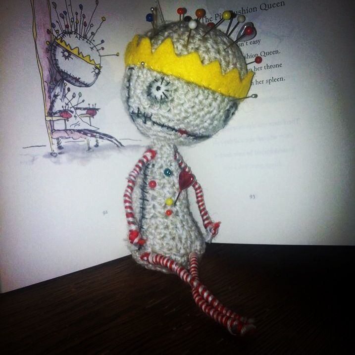 The Pincushion Queen Crocheted from this pattern http://www.etsy.com/listing/46444420/crochet-pattern-pin-cushion-queen