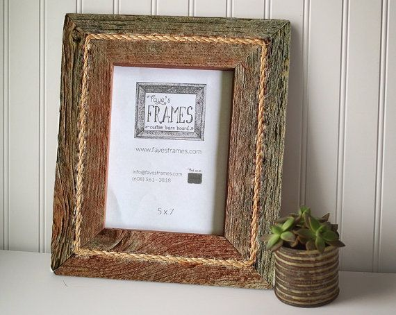 This beautiful 4x6 rustic reclaimed barn board wood frame with rope inlay is the perfect finishing touch to your cherished photographs. Our frames also make great gifts!  This listing is for an 8x10 opening single-style picture frame (one single board - no raised border) with authentic rope accent. All frames come with glass, chipboard backing, and flexible back tabs for easily switching out photos. A small alligator hanger is included for you to install for hanging either vertically or…