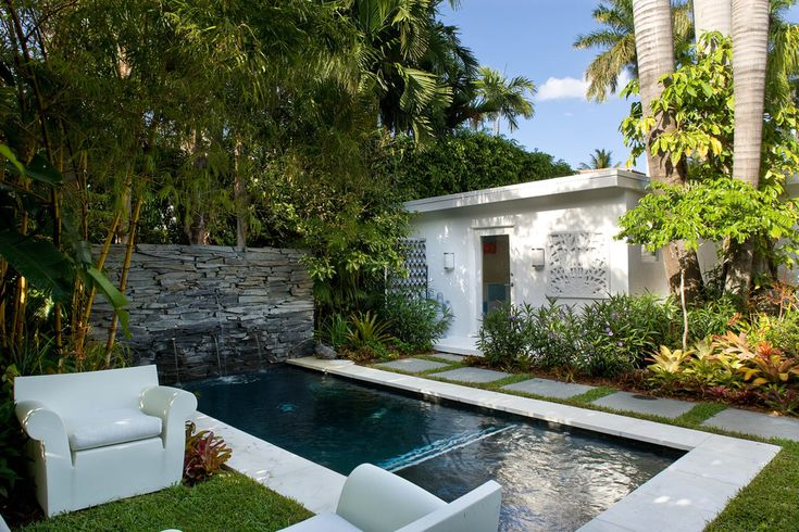 Plunge pool cost pool modern with white exterior stone water feature