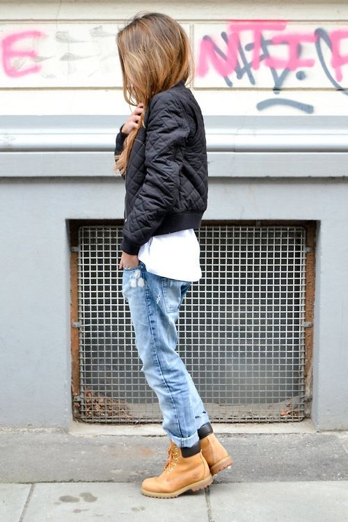 Pair a black quilted bomber jacket with light blue distressed boyfriend jeans for a casual-cool vibe. A pair of tan leather boots will be a stylish addition to your outfit.  Shop this look for $70:  http://lookastic.com/women/looks/black-bomber-jacket-white-crew-neck-t-shirt-light-blue-boyfriend-jeans-tan-boots/5644  — Black Quilted Bomber Jacket  — White Crew-neck T-shirt  — Light Blue Ripped Boyfriend Jeans  — Tan Leather Boots