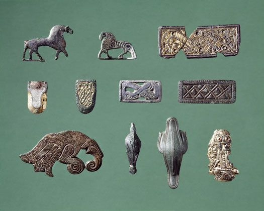 A small selection of the many gilded and tinned bronze-jewellery, which is found near Tissø. They are manufactured in the periode from the 6th - 8th century AD.