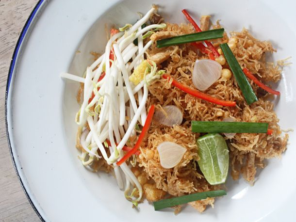 Mee Krob- This dish represents what people love so much about Central Thai cuisine: the interplay of sweet, sour, and salty that is not spicy.  Thin rice noodles are fried until thoroughly crispy before being coated with a sticky tamarind and palm sugar sauce. Permeating the crispy, sticky noodles are bits of chicken, shrimp, and fried tofu. More refined versions of Mee Grob often include Chinese chives, bean sprouts and thin slices of pickled garlic with a squeeze of lime