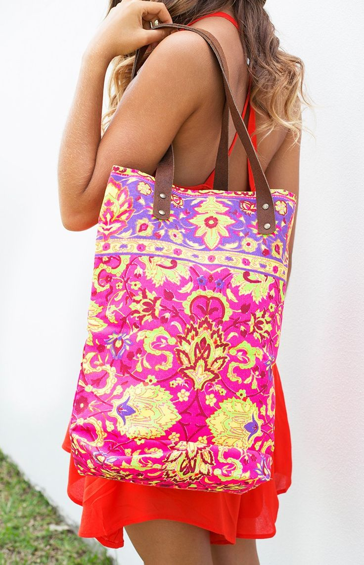 Ingrid Tote Pink. Ingrid Tote Pink will have you carrying your essentials in total style! This luscious BB tote features a stunning pink, yellow and purple floral style print and thick brown leather straps