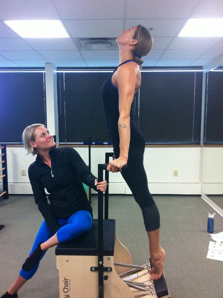 Instructor Trainer Amanda Fletcher from One Pilates Studio in Denver training with Cirque du Soleil performer Robyn Houpt