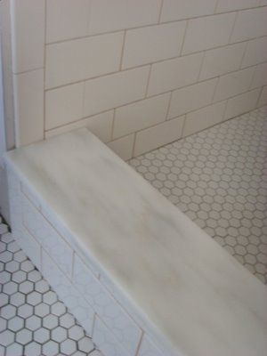 What's that, you ask? Why that's a bit of Danby Imperial marble. What's it doing here, you ask? Becoming the threshold to the shower in the bathroom, of course. (please ignore the fact that the tile isn't fully grouted yet!) --McKay