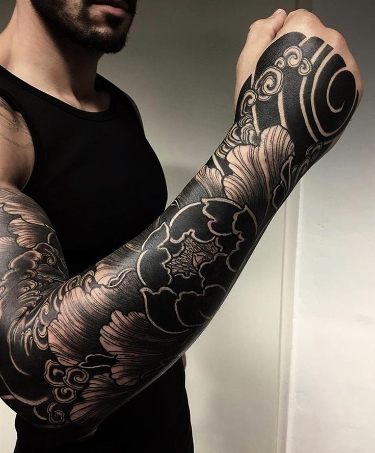 Really great Japanese tattoo sleeve. Super strong and bold. #CuratedTattoo.