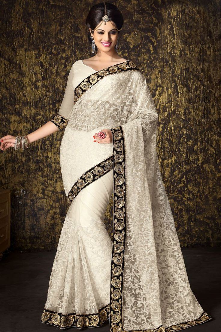 Wedding and Party wear Sari Collection like White Net Saree with Blouse presented by Andaaz Fashion with price RM445.00. Embellished with Embroidered, Stone, Zari, Heavy Pallu, V Neck Blouse.  http://www.andaazfashion.com.my/white-net-saree-with-blouse-dmv7498.html