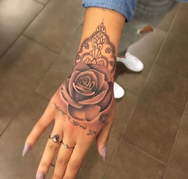 Hand tattoo. Rose.