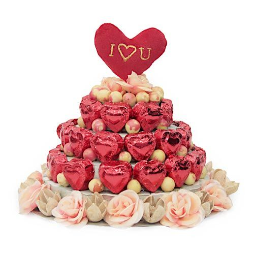Let your beloved know how she has turned your night into sunny dawns with her vibrant presence. Get an amazing 3 tier chocolate tower of 34 heart shaped chocolates beautifully decorated with artificial roses and berries on a hard base platform. To add a bit more romance to the tier, the tower included 2 inch I Love You written heart at the top of the tower. http://www.fnp.com/valentine/