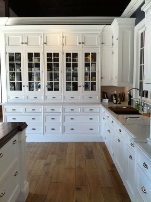Whole wall like this w/o glass where the oven is and put the fridge at the dining end. Stove/oven combo in the island.