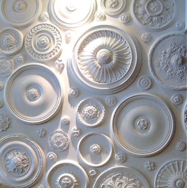 Plaster ceiling roses used as wall decor