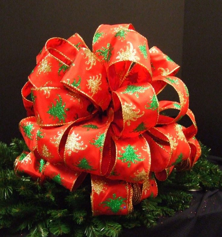 "Beautiful red, green, & gold Christmas tree ribbon made into a grand Christmas bow topper. This bow topper is made from 2.5"" ribbon.Christmas Tree Topper  Large (4) 8 ft Streamers."
