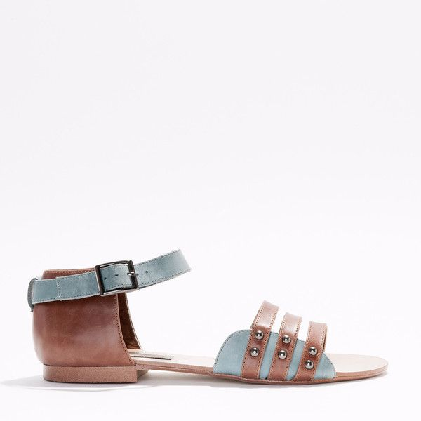 A two tone full leather women's sandal. Three straps across the front and a contrast leather detail with gunmetal studs and a resin outsole for longer wear.
