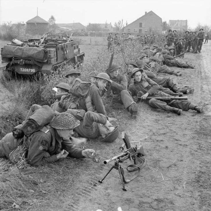 Infantry and carriers of 8th Royal Scots pause during the attack by 15th (Scottish) Division on Tilburg, 27 October 1944.
