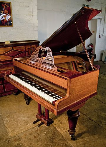 An 1899, Broadwood grand piano with a polished, rosewood case and elegant, filigree music desk at Besbrode Pianos £5500.