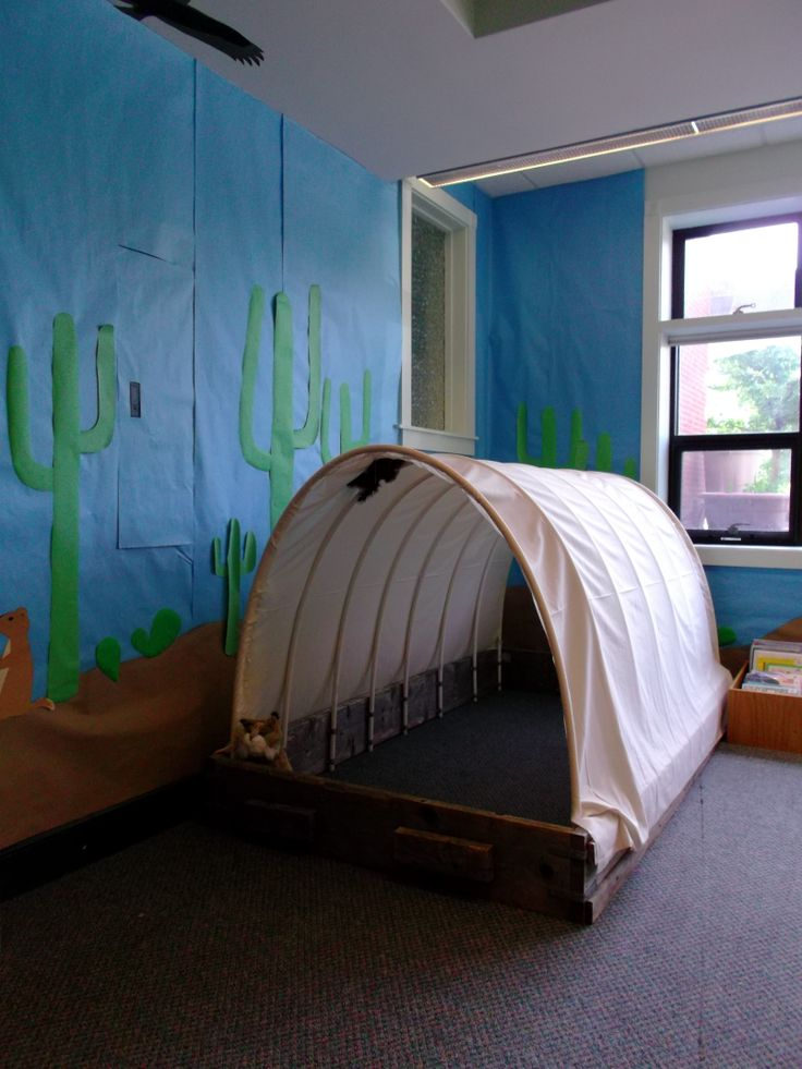For our wild west theme, we created a covered wagon that kids can play in!