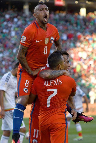 Arturo Vidal, Alexis Sanchez, and Eduardo Vargas celebrate.  Chile NT.  Copa America.