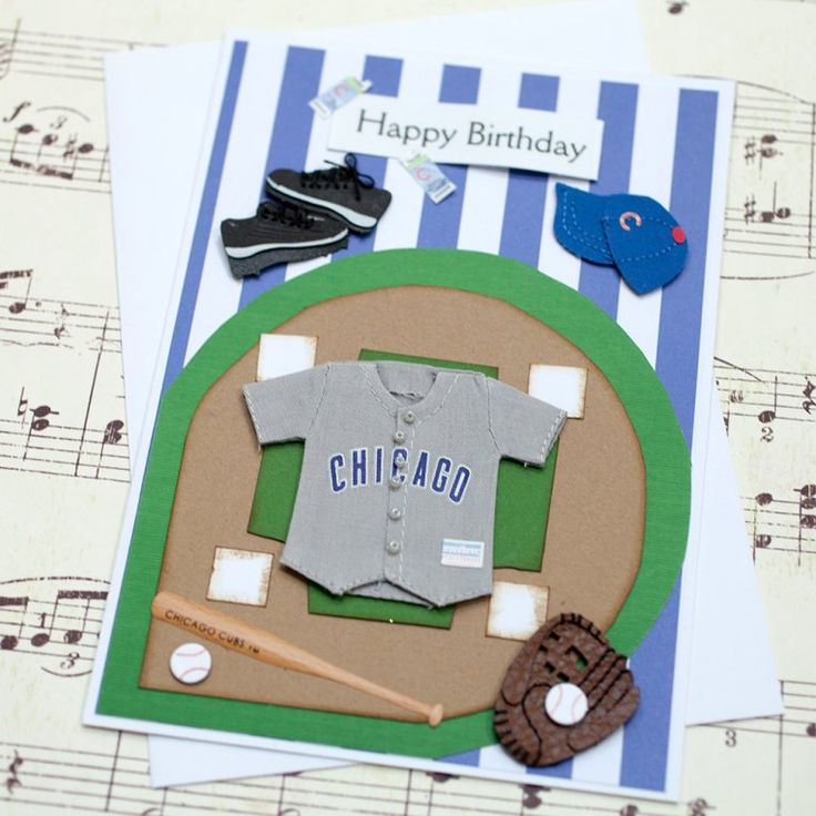 """Chicago Cubs Handmade Birthday Card - This Chicago Cubs birthday card is the perfect birthday greeting card to give to your favorite die hard Chicago Cubs fan! This card features a three dimensional Chicago Cubs jersey, Cubs baseball hat, baseball bat, baseball and catchers mitt layered on top of a baseball diamond and blue and white stripped paper. """"Happy Birthday"""" is printed on front of the card. The inside of this baseball birthday card is left blank for your own heartfelt message."""