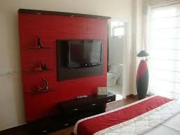 Image result for dark brown furniture with red walls