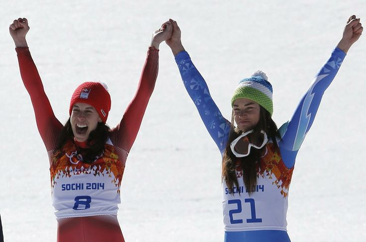 It came down to the last hundredth of a second, but Switzerland's Dominique Gisin and Slovenia's Tina Maze managed the first ever draw in Olympic Alpine skiing history.