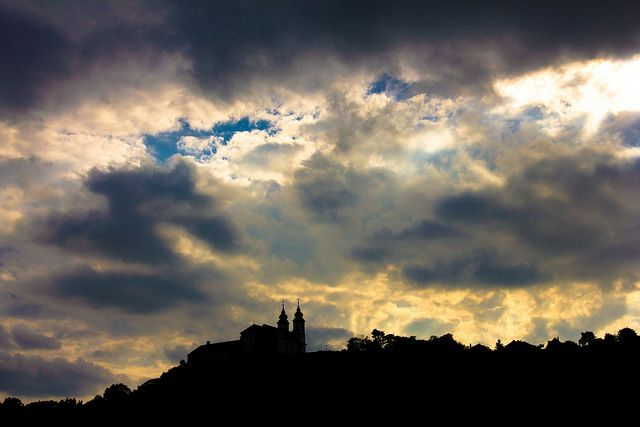 """TIHANY is a village overlooking Lake Balaton.  Its abbey, the silhouette of which is visible in this photo, is a Benedictine monastery established in 1055.  Photo """"Ciao Tihany!"""" by Hannes Vogel, flickr user hannesvogel."""