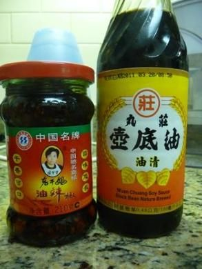 Wuan Chuang Soy Sauce (Black Bean Nature Brewed) & Lao Gan Ma Spicy Chili Sauce / Recipe Spicy Noodles: (1)Boil plain wheat noodles (Twin Marquis thin Shanghai style, but any white wheat noodles will do.)  (2)Mix 1/2 Tbsp LGM Sauce (to taste), 1 Tbsp WC soy sauce, 1/2 Tbsp black vinegar, ½ tsp sugar.   (3)Add noodles to condiments, mix well. Add ½ to 1 Tbsp of peanut powder to give the noodles a thicker texture/peanut flavor. Garnish w/ scallions & Sichuan peppercorn powder.