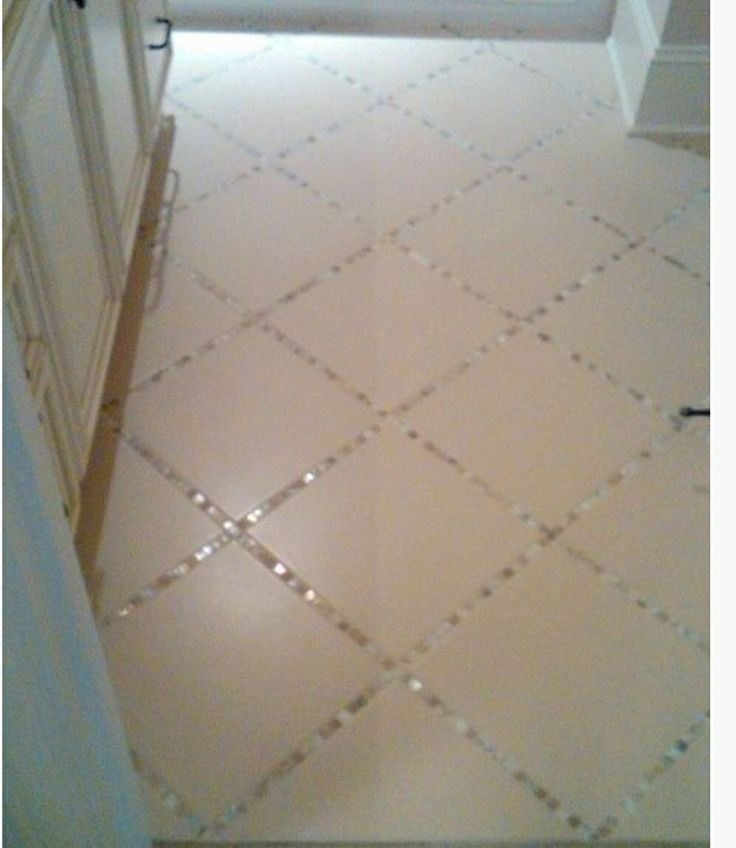 Lay thin strips of mosaic tile between larger tiles