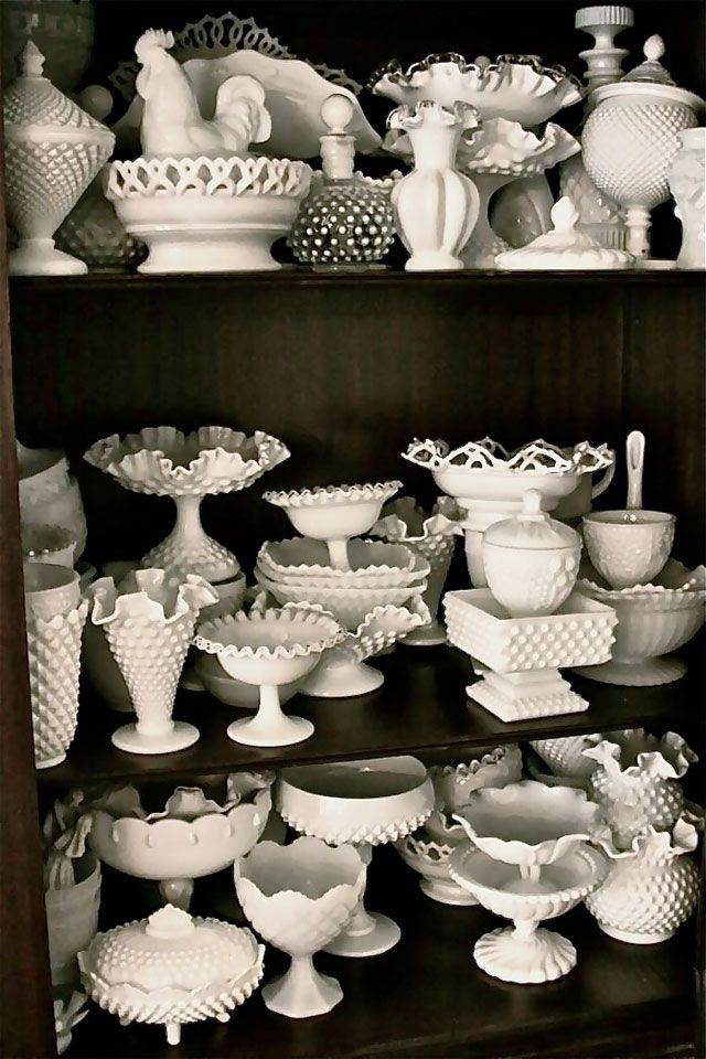 Really like how this collection of milkglass looks against the dark cupboard.  Really like the hobnail designs and those that look like cut lace.