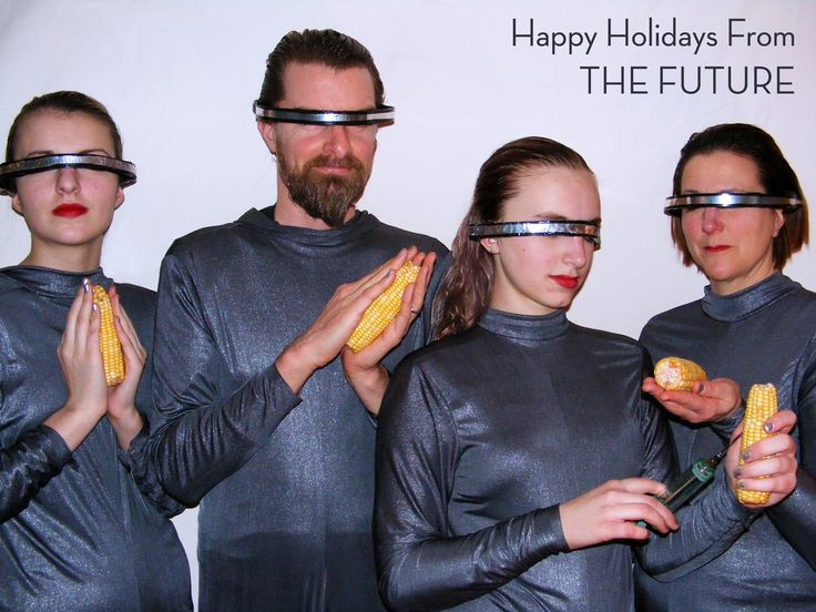 """Our family greeting card from last year.  My daughter loved this strange clip art (google cyber corn woman clip art) and had the idea that we should use that as our template for our family holiday photo."""" (submitted by Ellie)"""