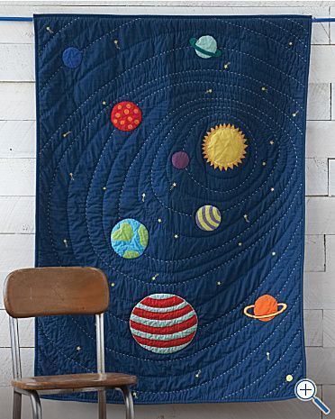 Solar System Quilt - looks a little tricky but not as time-consuming as hundreds of tiny pieces - sew planets and stars onto the blue base, then quilt in circles/a spiral.