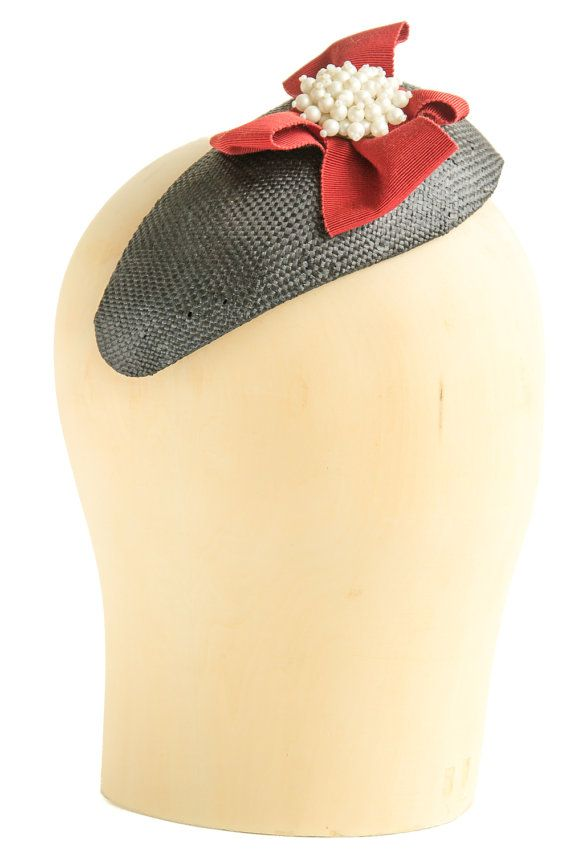 Handmade tear-shaped black paper straw fascinator. Finished with a red bow and a vintage pearl brooch. Attaches with millinery elastic. #millinery #2016