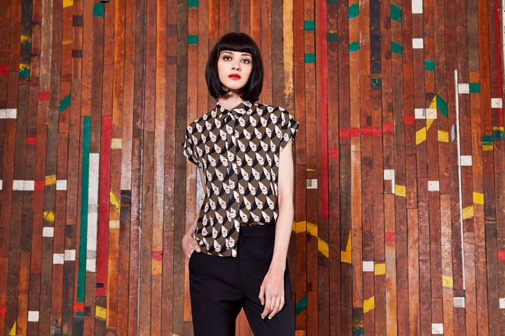 Patterned brown and white, short sleeved shirt, paired with black jeans by Louche London.