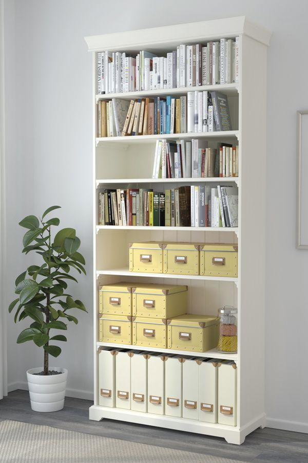 Keep your home office organized! Storage boxes like the IKEA FJÄLLA boxes with lids are suitable for papers, photos and other keepsakes. The label holder and handle on the outside of the box helps to keep you organized and find what you're looking for in no time.