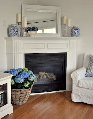 symmetry  Fire place mantle, a small amount of accessories allows the fire place itself to shine through. With a touch of elegance.