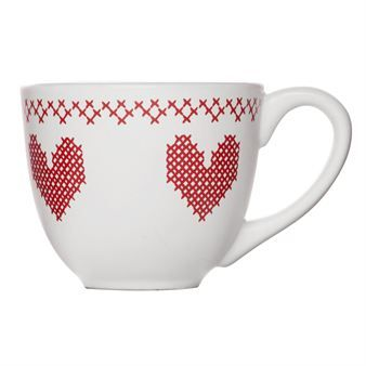 The white mug for mulled wine has a red pattern of traditional cross stitches, and is part of the X-mas series of Christmas products from the Swedish company Sagaform. The series also contains a small bowl and a jug for mulled wine with heater.