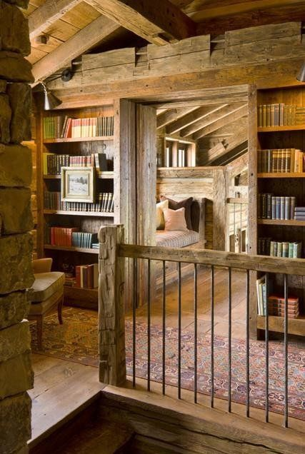Nice bookshelves on each side of the door... great idea for a reading area in a loft.