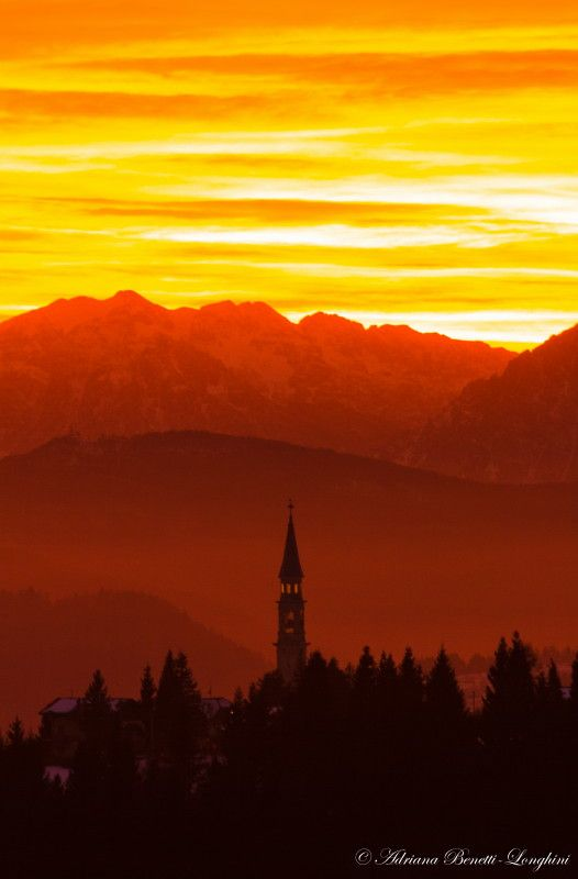 The steeple and the sunset - Asiago, Italy Copyright: adriana benetti longhini