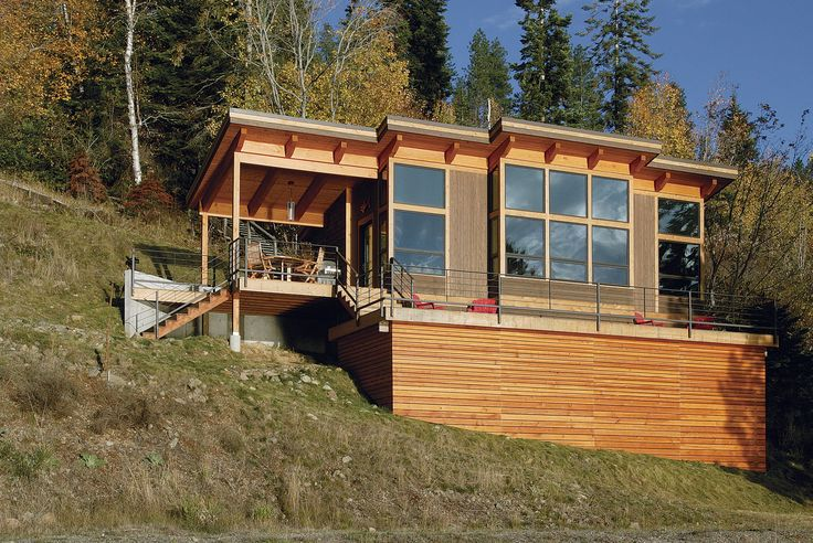 Glowing in the light of a western sunset, the abundance of Douglas fir imbues the modern cabin with a natural warmth.